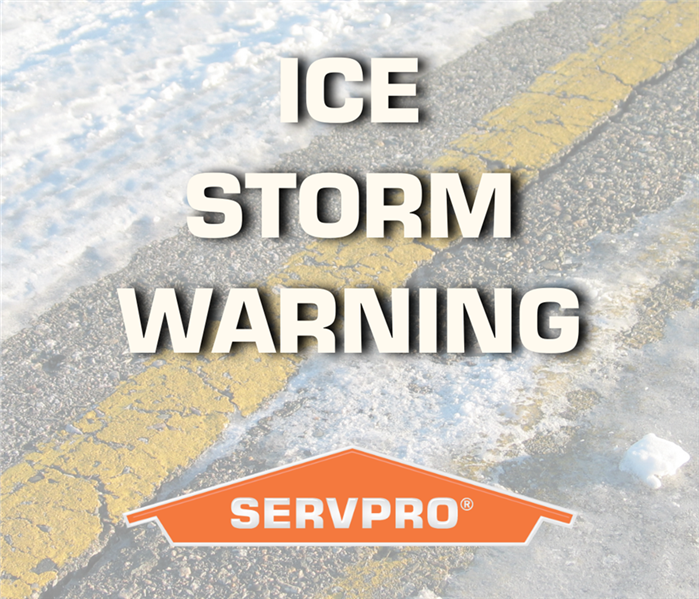 "Blured out road with ice and snow covering it. Orange SERVPRO logo at bottom of photo, with the words ""Ice Storm Warning"""