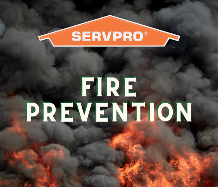 "Photo of smoke and fire. Orange SERVPRO logo at top of photo with ""Fire Prevention"" written in the center in white letters"