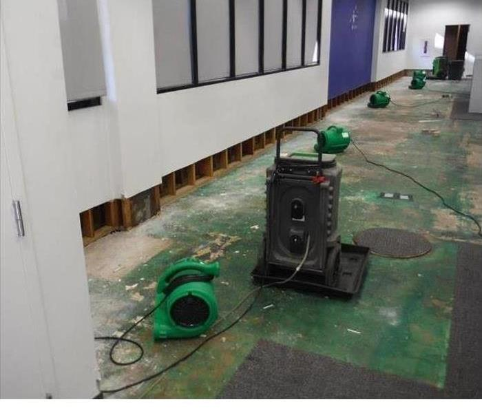 commercial water loss, torn up floor, air movers